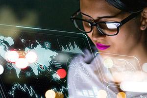 woman looking at computer reflection
