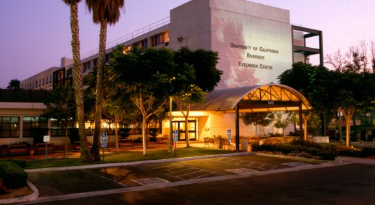 night time outside photo of the UCR Extension Center campus building